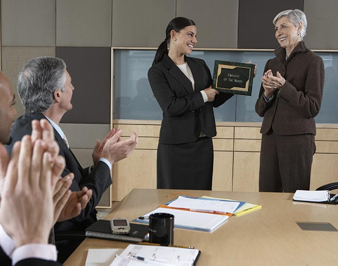 award-executives-applauding-woman-standing-up